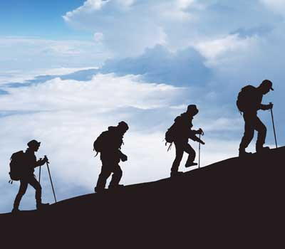 four climbers on upward slope